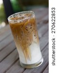 iced coffee with milk is on the ... | Shutterstock . vector #270622853