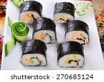 japanese maki sushi rolls set with salmon and avocado - stock photo