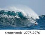 A Surfer Catches A Huge Wave.