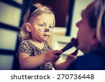 Little Girl Trying To Paint He...