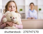 Little girl with teddy bear is...