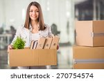 Young Woman Holding Box With...