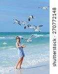 Young Woman Feeding Seagulls O...