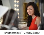 Small photo of BANGKOK, THAILAND - FEBRUARY 13: Michelle Yim in elegance red dress on location for shooting advertorial on February 13rd 2015, in Bangkok, Thailand.