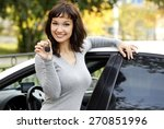 pretty girl in a car showing... | Shutterstock . vector #270851996