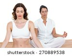 women sitting in lotus pose on... | Shutterstock . vector #270889538