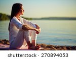 Tranquil Young Woman Sitting O...
