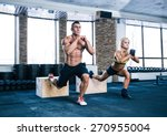 Woman And Man Working Out With...