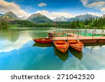 Colorful wooden boats and stunning mountain lake in National Park High Tatra,Strbske Pleso,Slovakia,Europe - stock photo