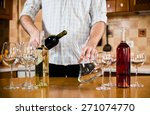 man pouring red wine from... | Shutterstock . vector #271074770