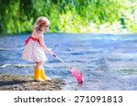 Child Playing In A River. Cute...