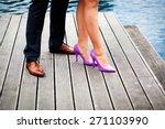Elegant Couple's Legs On Woode...