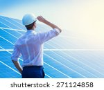 solar power plant. man standing ... | Shutterstock . vector #271124858