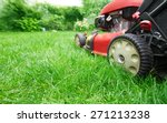 lawn mower cutting green grass... | Shutterstock . vector #271213238