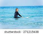 a young surfer with his board... | Shutterstock . vector #271215638