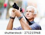 senior man with camera in city | Shutterstock . vector #271215968