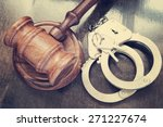 Gavel And Handcuffs On Wooden...