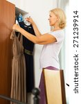 Mature Woman Looking At Clothe...