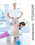 trainer working with woman on... | Shutterstock . vector #271245149