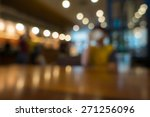 Stock photo blur or defocus image of coffee shop or cafeteria for use as background 271256096