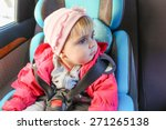 little girl sits in car seat.... | Shutterstock . vector #271265138