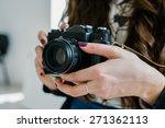 vintage old camera in hand | Shutterstock . vector #271362113