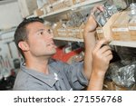 man choosing parts from stores | Shutterstock . vector #271556768