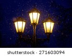 Triple Lantern On A Dark Blue...