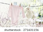 Stock photo baby clothes hanging on the clothesline 271631156