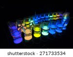 Shot Glasses with Glow Stick Juice - stock photo