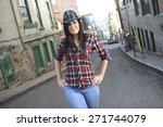 a woman walking on the street... | Shutterstock . vector #271744079