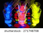 Glow Stick Juice in Shot Glasses with Syringes - stock photo