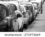 Stock photo black and white photograph of cars parked in city centre 271973669