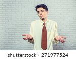 "young man posing ""don't know"" 