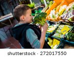 boy holding fresh vegetables... | Shutterstock . vector #272017550