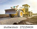 grader leveling gravel on road... | Shutterstock . vector #272154434