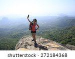young woman hiker taking photo... | Shutterstock . vector #272184368