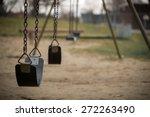 Children's Swings Hang Empty A...