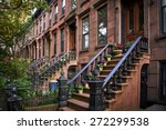 Summer View Of A Row Of Stoop...