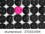Small photo of several rows of black buttons on a white background, among them the one bright pink, stands out concept, to be bright, life style