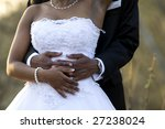 An newly-wed African-American couple holding each other - stock photo