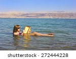 Beautiful Young Woman Reads A...