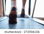 man running in a gym on a... | Shutterstock . vector #272506136
