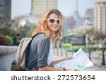 happy young woman with a city... | Shutterstock . vector #272573654