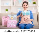Happy Pregnant Woman Is Sittin...
