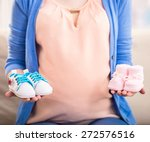 Pregnant Woman Is Holding Smal...