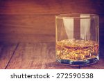 glass of whiskey with ice on a... | Shutterstock . vector #272590538