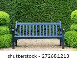 Blue Bench In Garden.