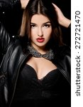 beautiful woman in a leather... | Shutterstock . vector #272721470
