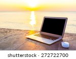 Laptop On Table At Sea Sunset...